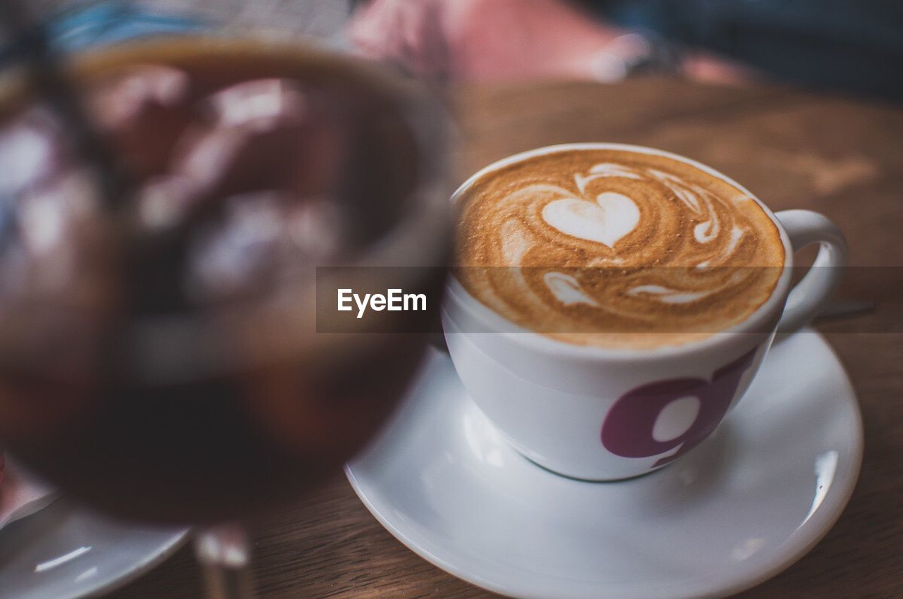 coffee - drink, coffee cup, refreshment, drink, saucer, food and drink, froth art, frothy drink, table, cappuccino, indoors, latte, focus on foreground, close-up, no people, freshness, day