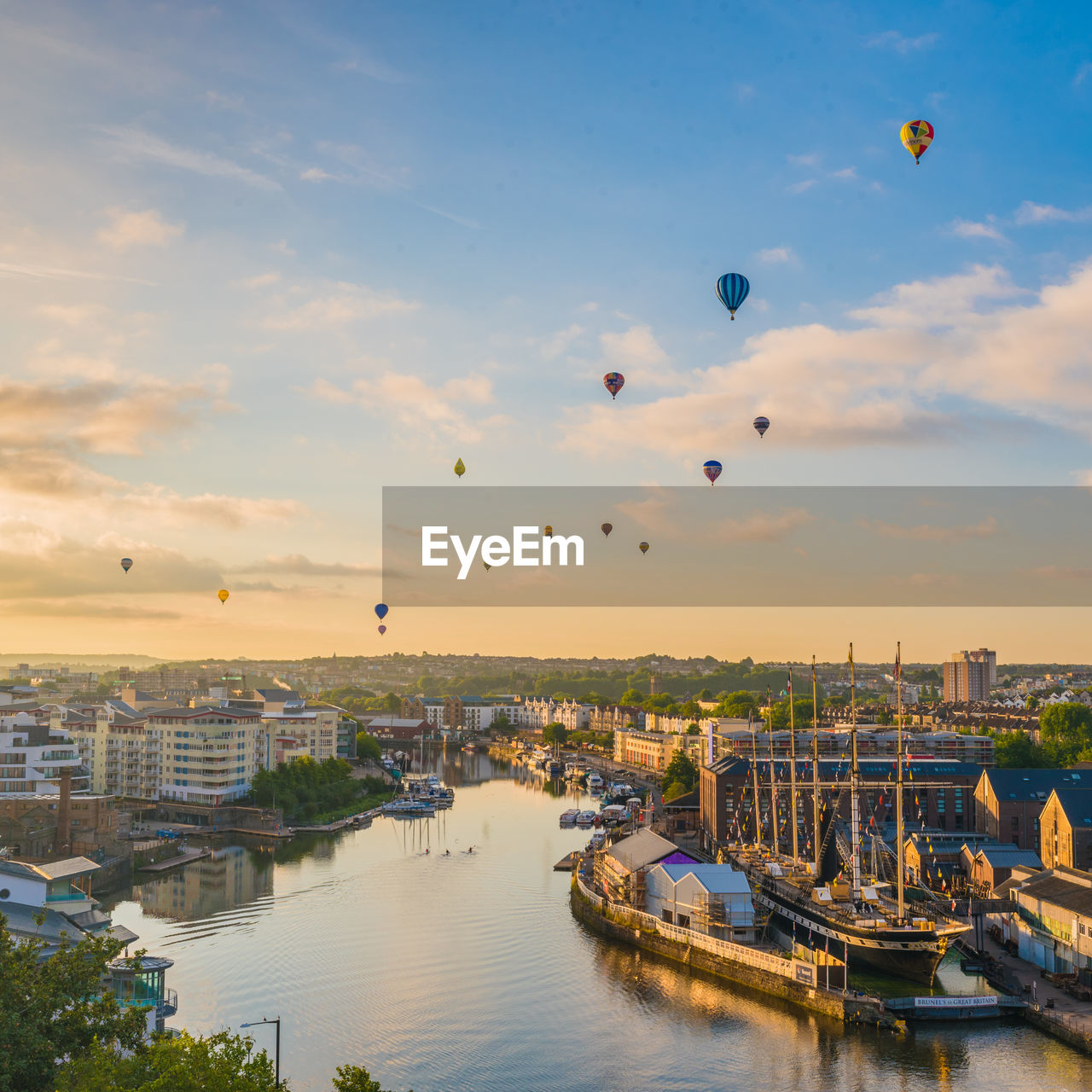 transportation, water, sky, architecture, nautical vessel, built structure, mode of transportation, building exterior, balloon, city, nature, no people, hot air balloon, flying, air vehicle, cloud - sky, sunset, mid-air, river, cityscape, outdoors, passenger craft