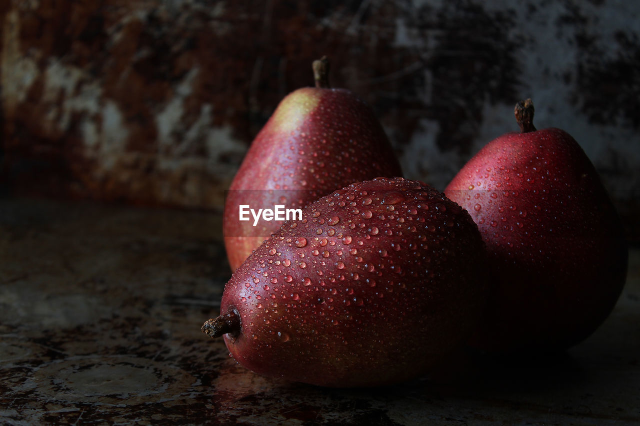 Close-up of wet apples on table