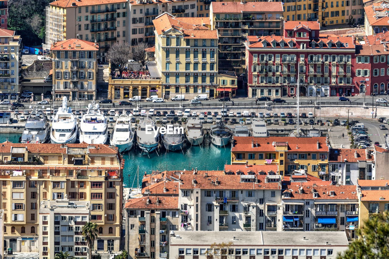 Aerial View Of Boats Moored At Harbor In City