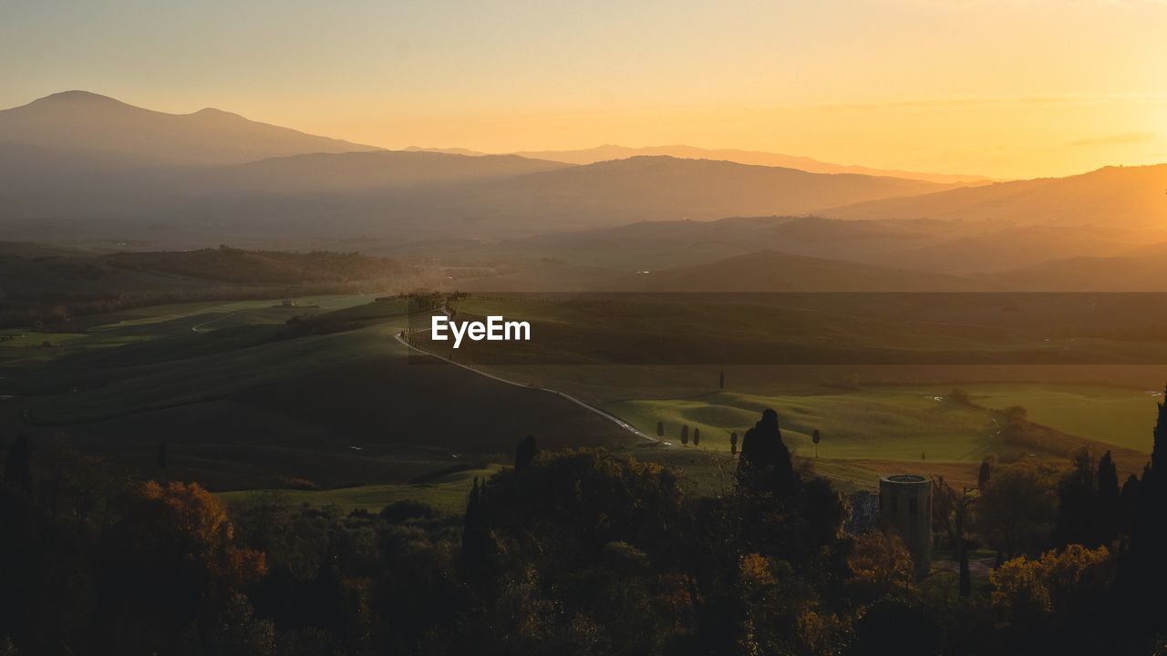View over tuscany hills during sunset in autumn
