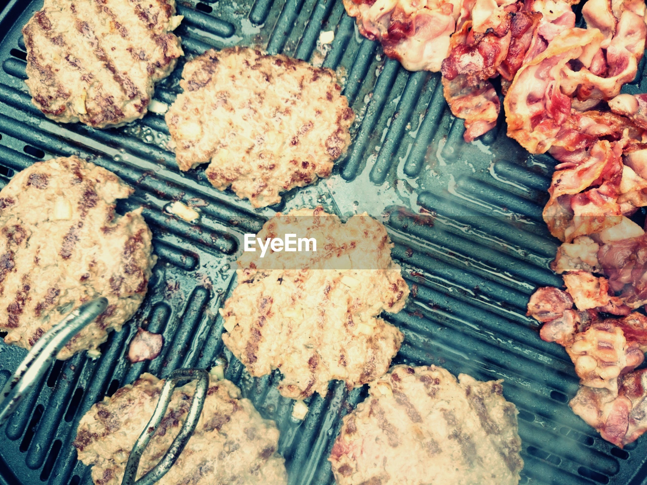 High angle view of meat being grilled on barbecue