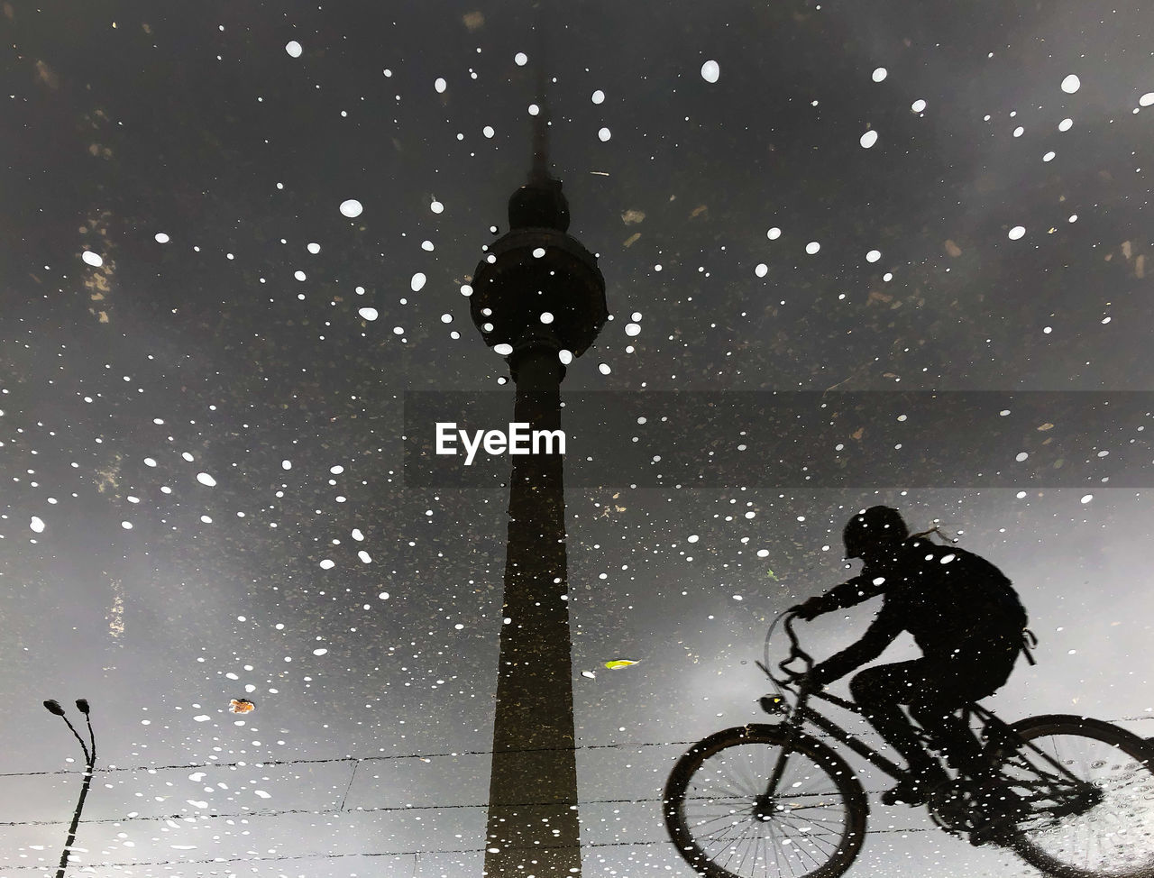 one person, street, sky, night, cold temperature, snowing, snow, winter, street light, nature, full length, real people, silhouette, transportation, illuminated, lighting equipment, men, leisure activity, outdoors, riding, light