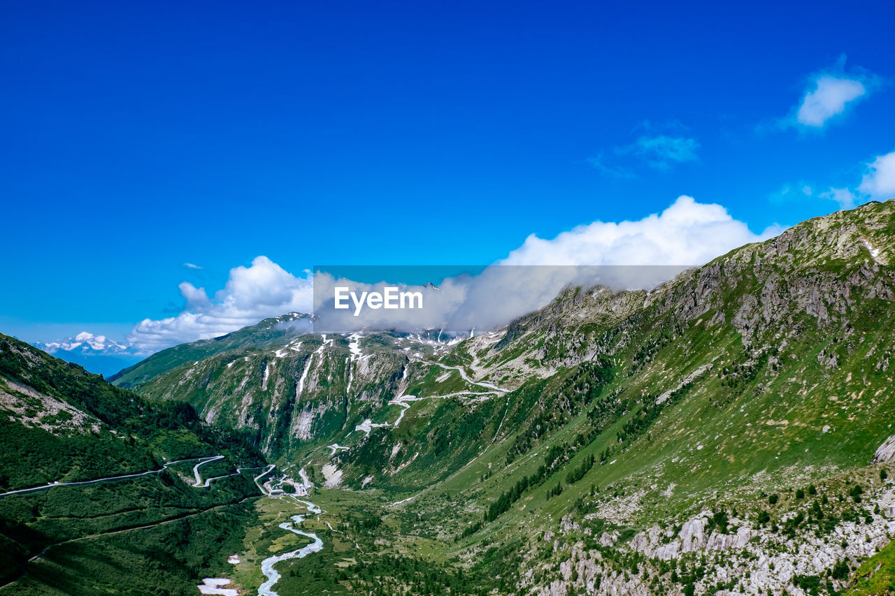 Idyllic view of alps against blue sky