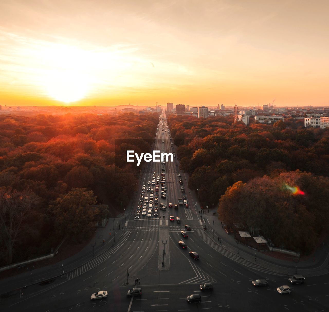HIGH ANGLE VIEW OF HIGHWAY IN CITY AT SUNSET
