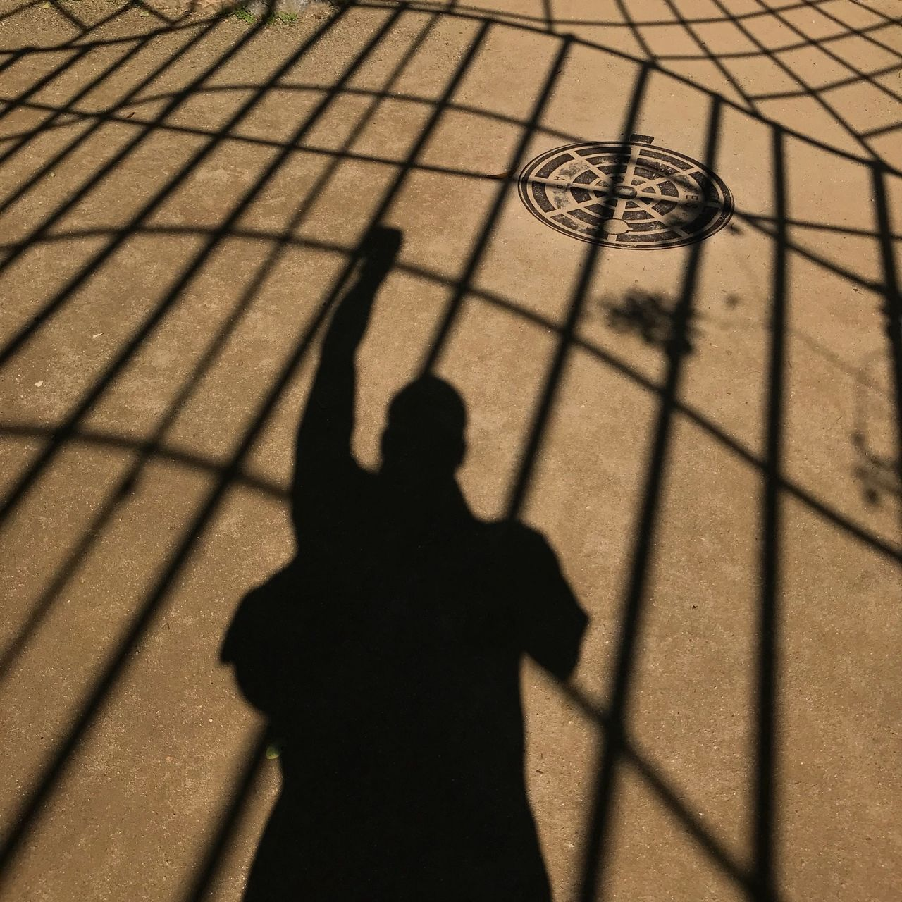 shadow, sunlight, focus on shadow, nature, high angle view, day, real people, leisure activity, lifestyles, outdoors, people, sport, standing, pattern, men, silhouette, human representation, representation