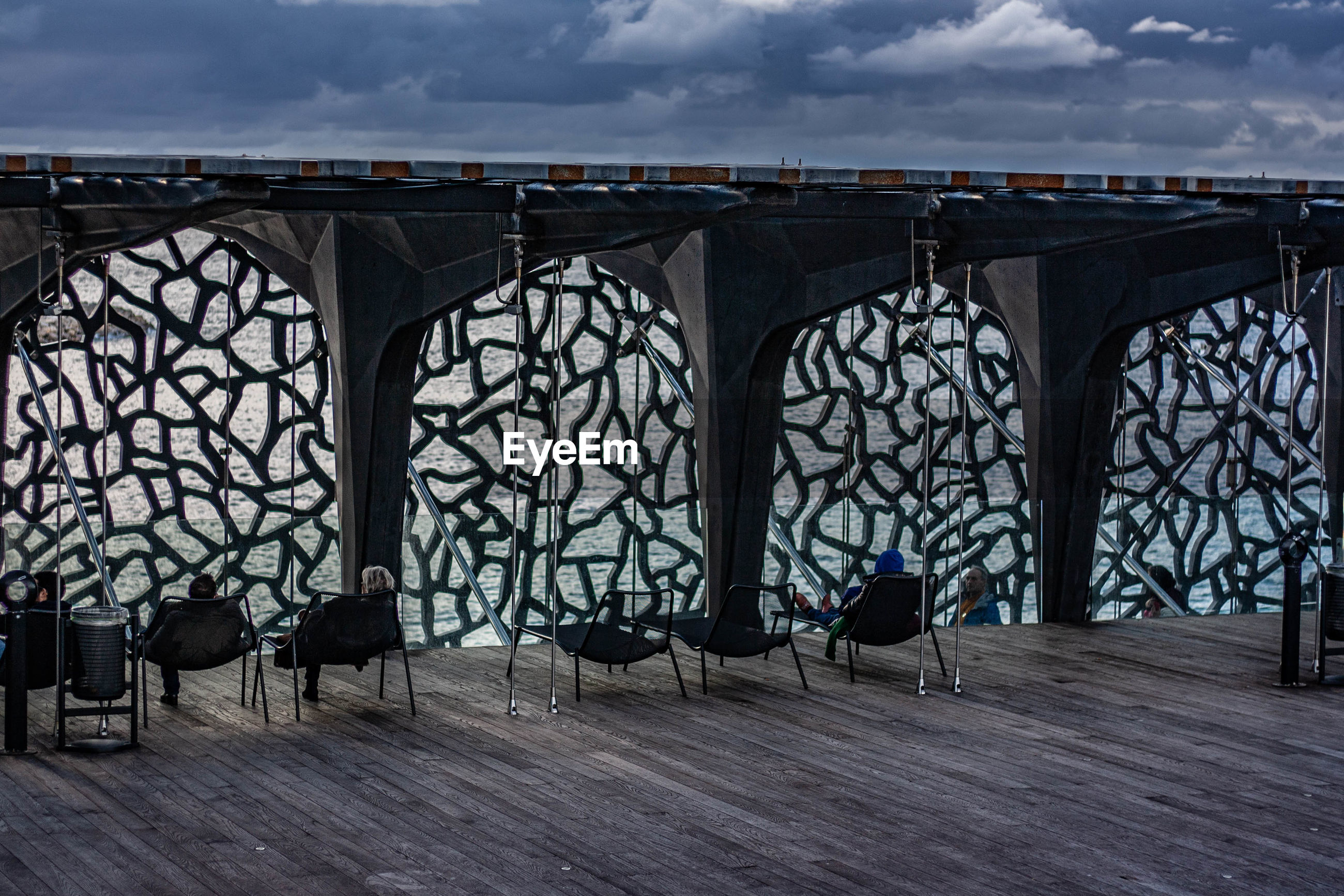 VIEW OF EMPTY CHAIRS AGAINST WALL IN PARK