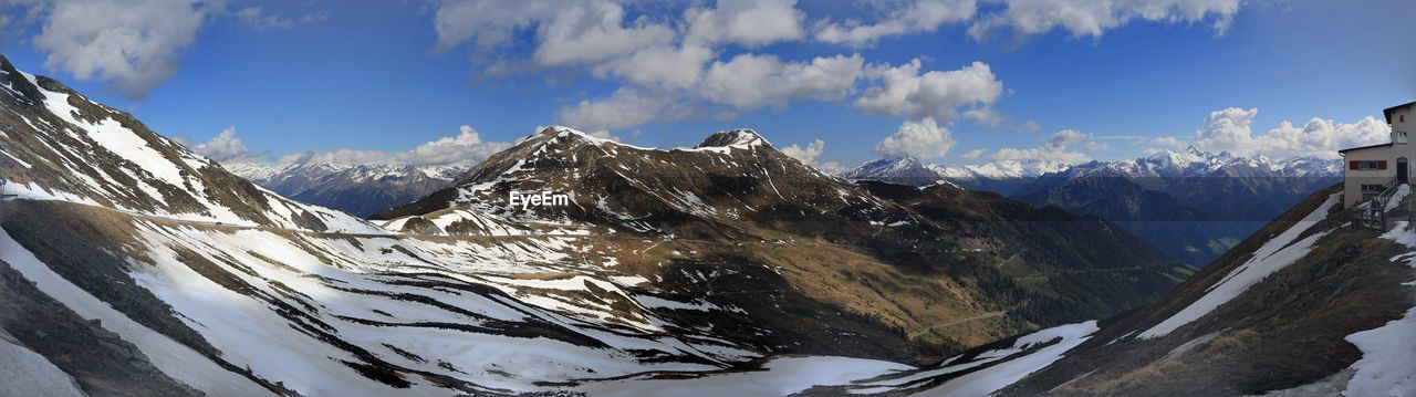 mountain, sky, winter, beauty in nature, cold temperature, snow, scenics - nature, mountain range, cloud - sky, environment, landscape, tranquil scene, nature, panoramic, tranquility, non-urban scene, snowcapped mountain, day, no people, mountain peak, outdoors, formation, range