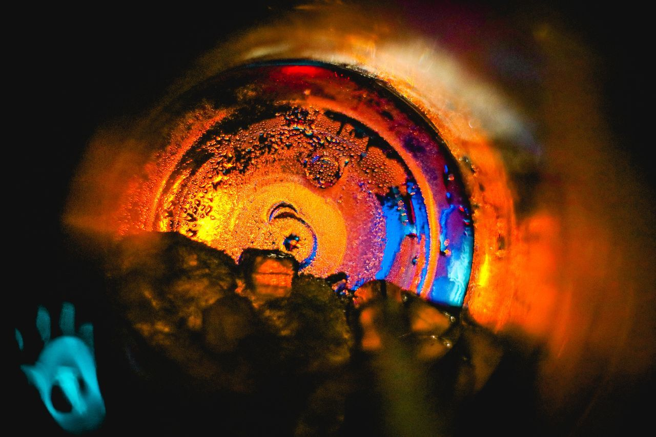 close-up, selective focus, indoors, no people, heat - temperature, red, illuminated, orange color, metal, backgrounds, night, glowing, nature, multi colored, burning, glass - material, wet, fire