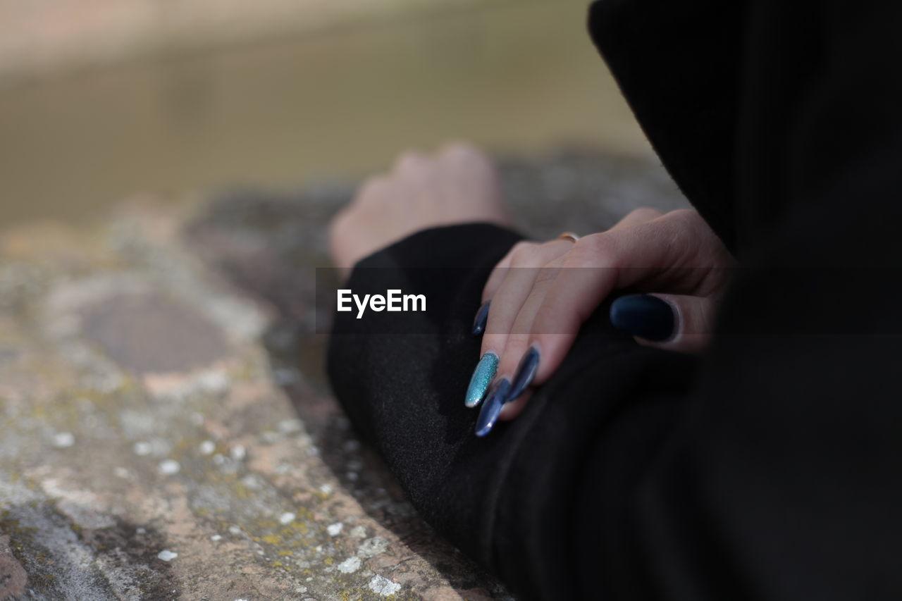 Cropped Image Of Woman Showing Nail Polish