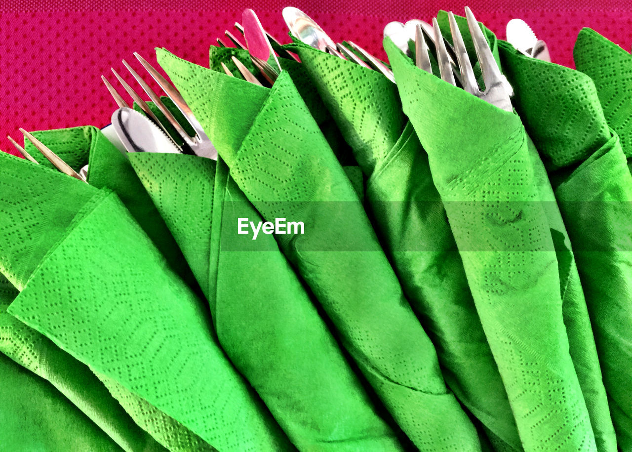 green color, indoors, no people, close-up, textile, clothing, choice, still life, backgrounds, high angle view, clean, variation, kitchen utensil, hygiene, side by side, multi colored, group of objects, sweater, pattern, garment