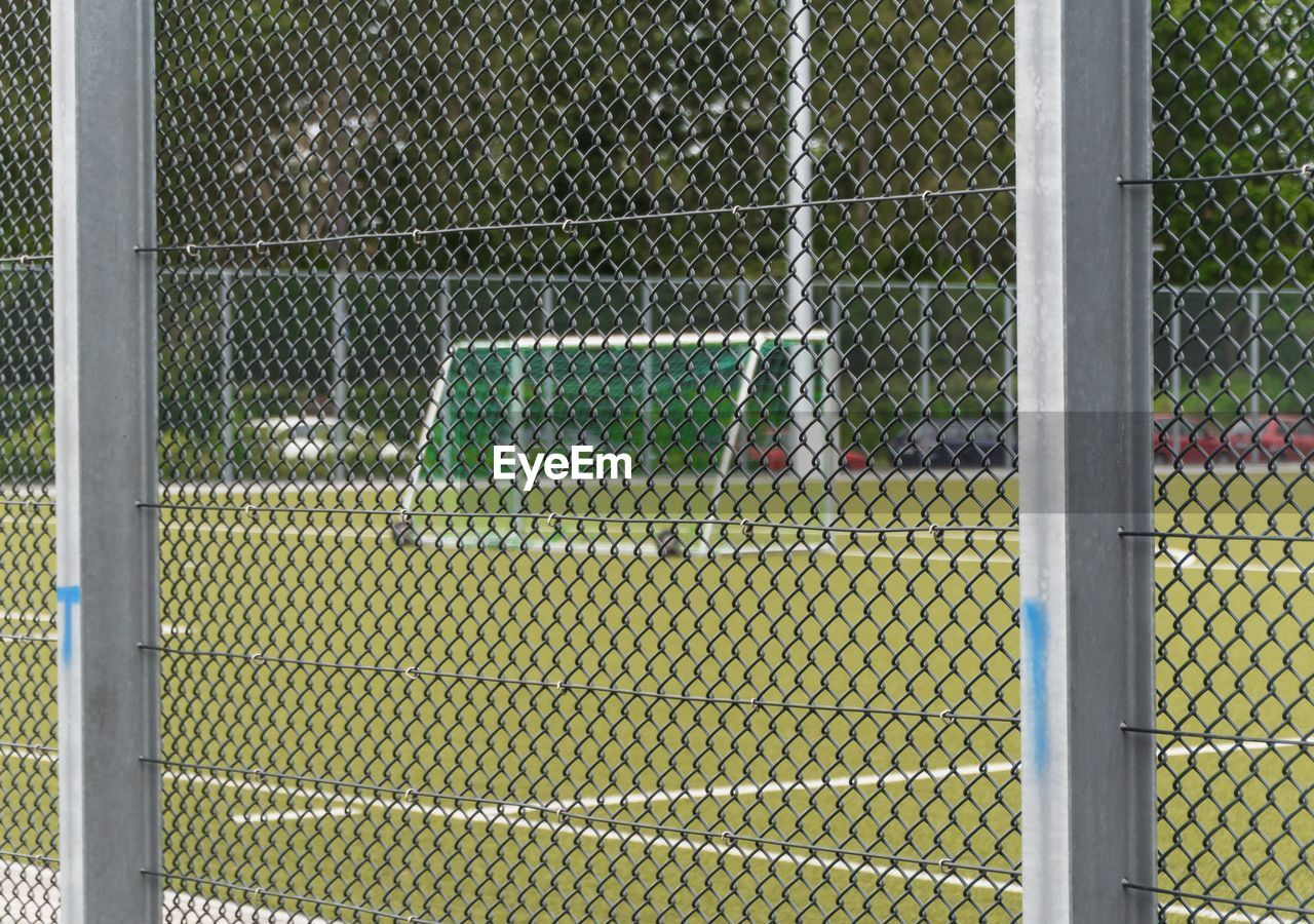 Sports Ground With Fence In Foreground
