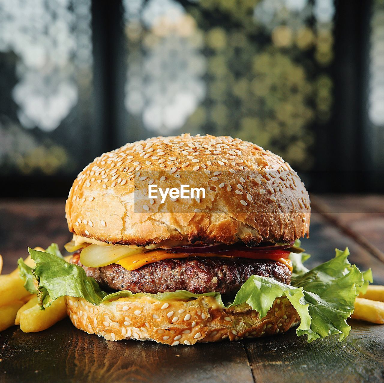 fast food, burger, unhealthy eating, sandwich, food and drink, freshness, ready-to-eat, hamburger, food, close-up, bread, focus on foreground, bun, meat, sesame, no people, vegetable, seed, table, lettuce, take out food, cheeseburger, snack, temptation