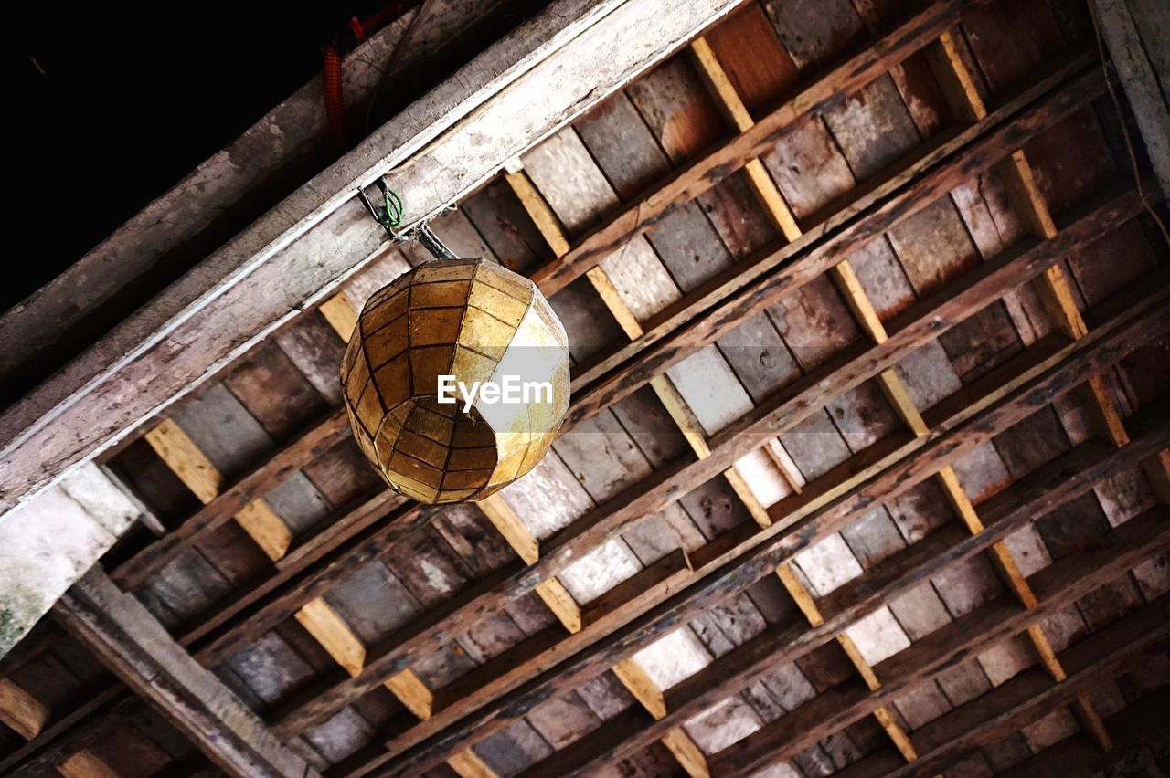 Low Angle View Of Lantern Hanging From Ceiling