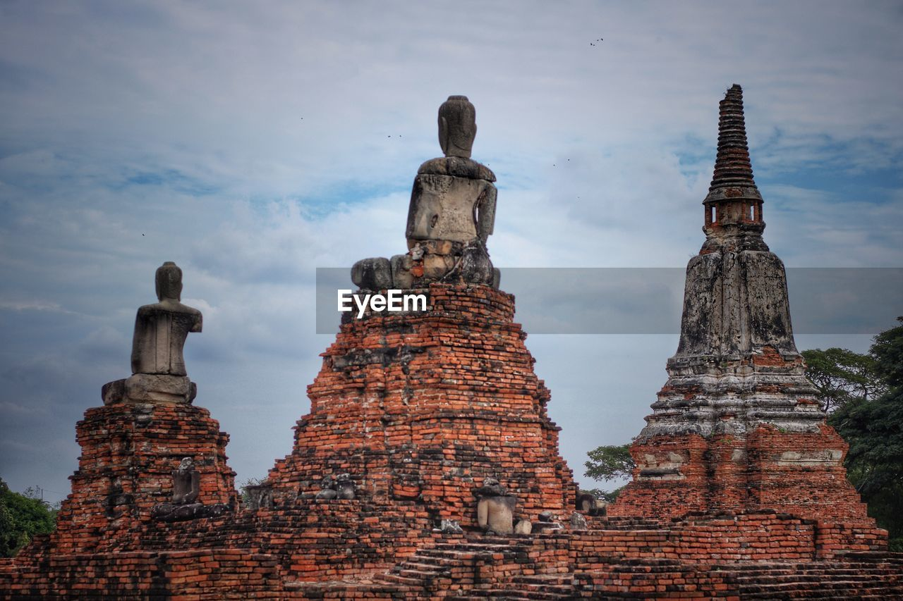 religion, built structure, architecture, belief, place of worship, spirituality, travel destinations, the past, history, building, sky, old, travel, no people, art and craft, cloud - sky, human representation, representation, outdoors, ancient civilization, ruined