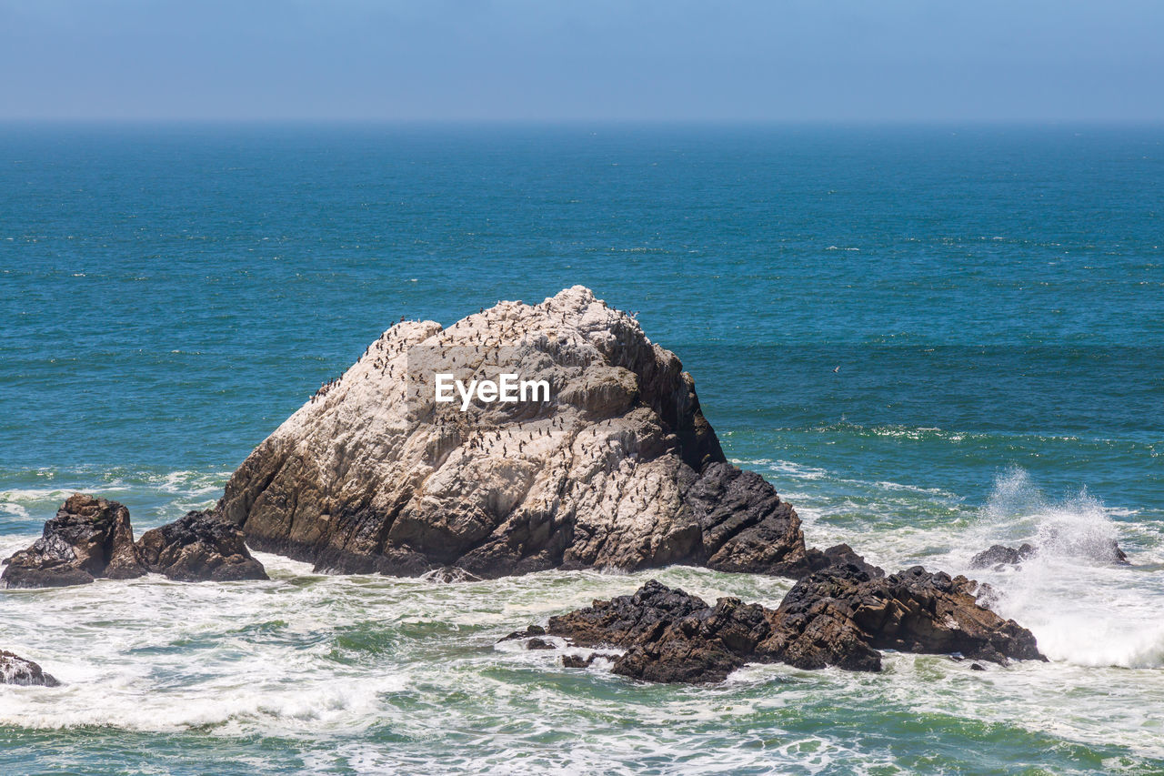 sea, rock, beauty in nature, rock - object, water, horizon, horizon over water, solid, scenics - nature, sky, rock formation, nature, motion, land, beach, day, no people, wave, tranquil scene, outdoors, stack rock, eroded, power in nature