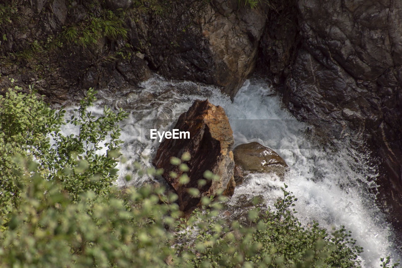 water, rock, scenics - nature, beauty in nature, motion, rock - object, plant, waterfall, nature, land, no people, tree, rock formation, long exposure, solid, non-urban scene, flowing water, day, environment, outdoors, flowing, power in nature