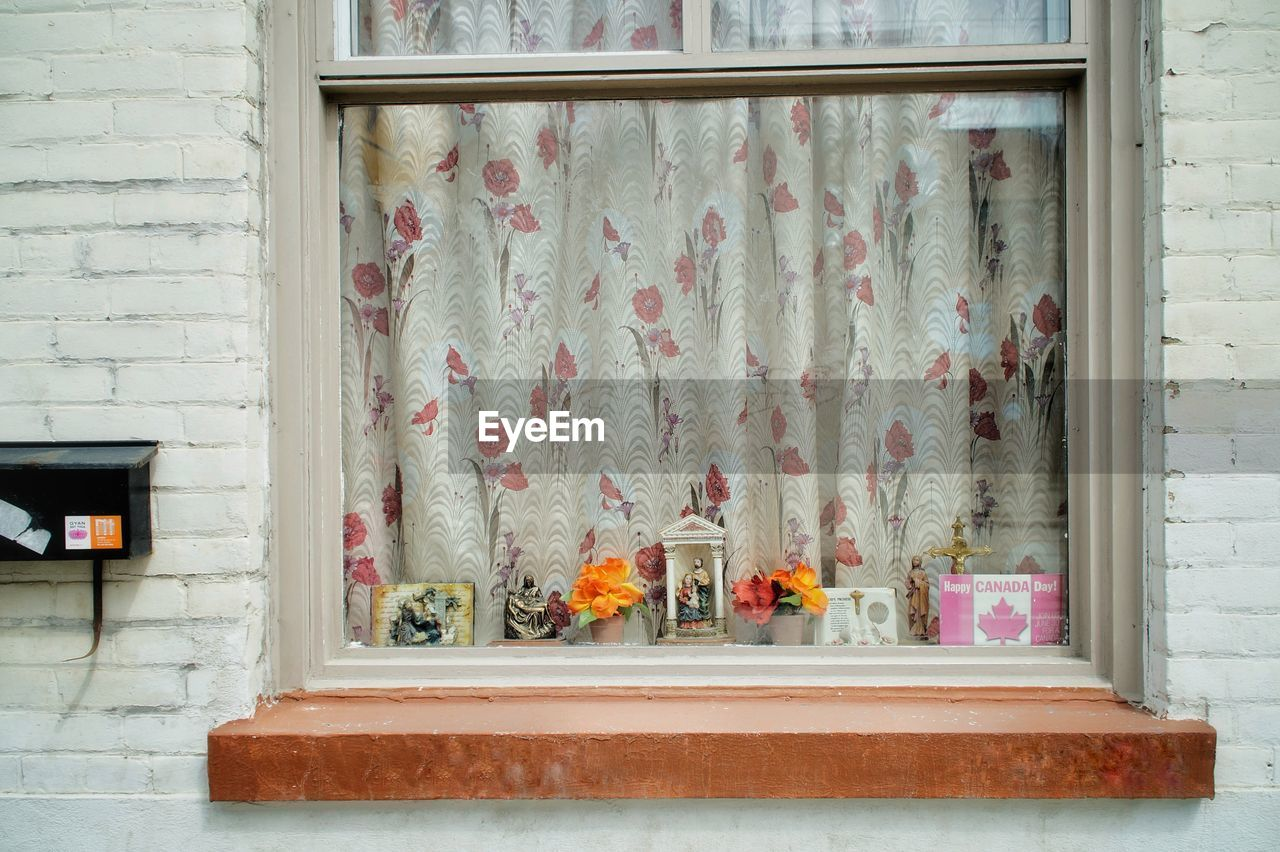 flower, flowering plant, window, architecture, day, building exterior, no people, built structure, plant, wall - building feature, brick, outdoors, wall, brick wall, house, building, potted plant, freshness, nature, window sill, tray, flower pot