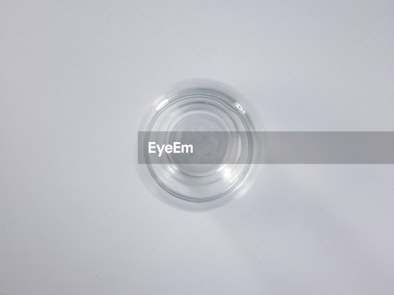 High Angle View Of Empty Glass Against White Background