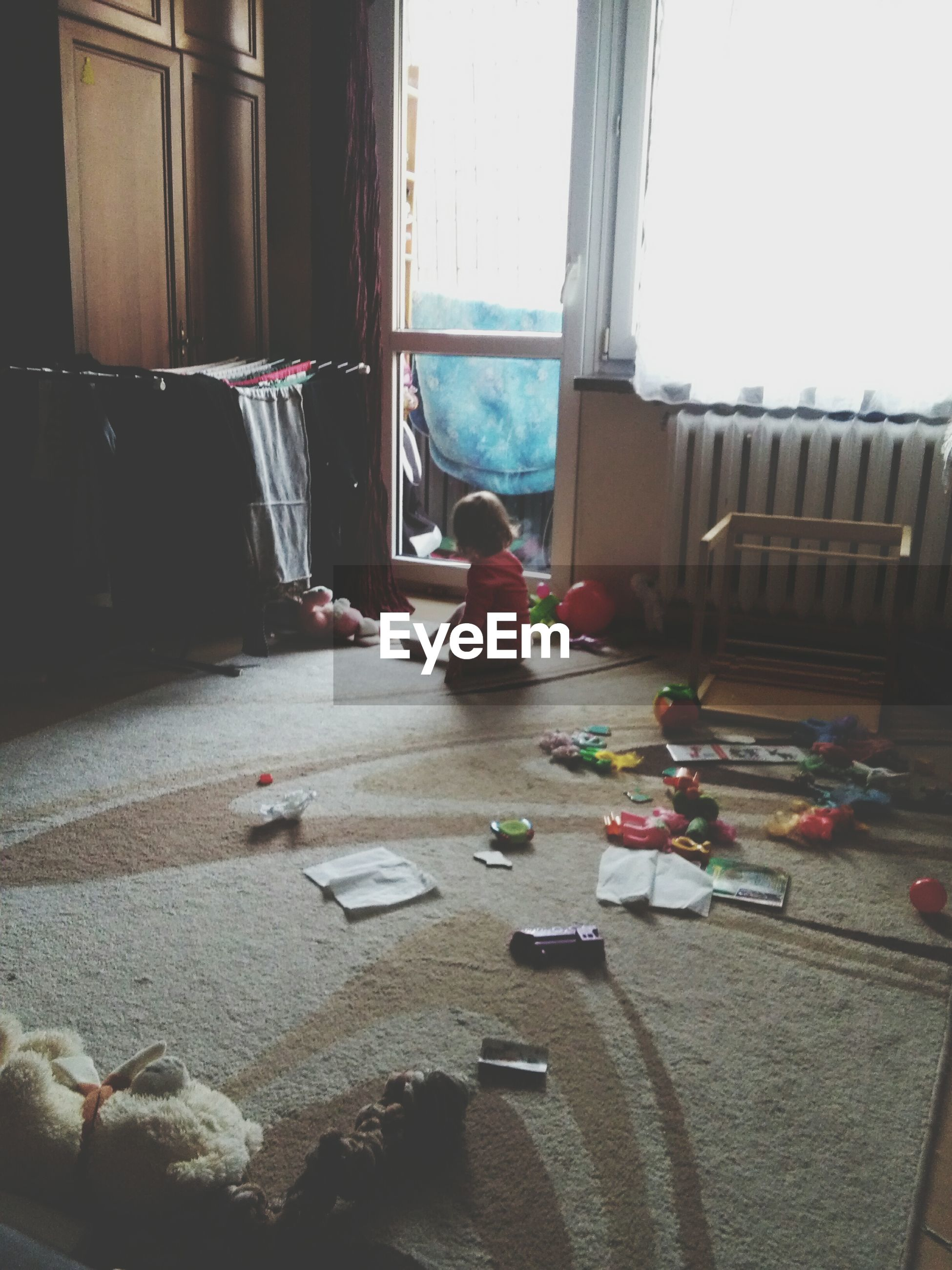 Toddler playing with toys in room at home