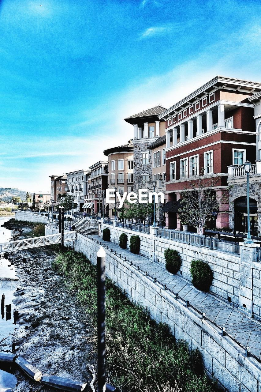 architecture, building exterior, built structure, sky, building, cloud - sky, city, nature, residential district, day, no people, water, plant, blue, outdoors, transportation, house, canal, street, apartment