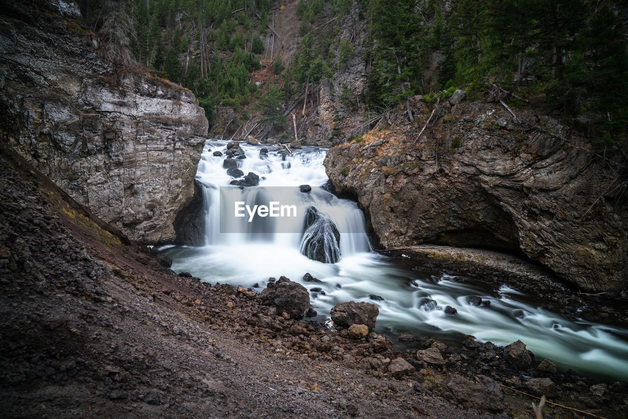 waterfall, motion, nature, long exposure, rock formation, blurred motion, rock - object, beauty in nature, water, forest, scenics, no people, tree, outdoors, day, sky