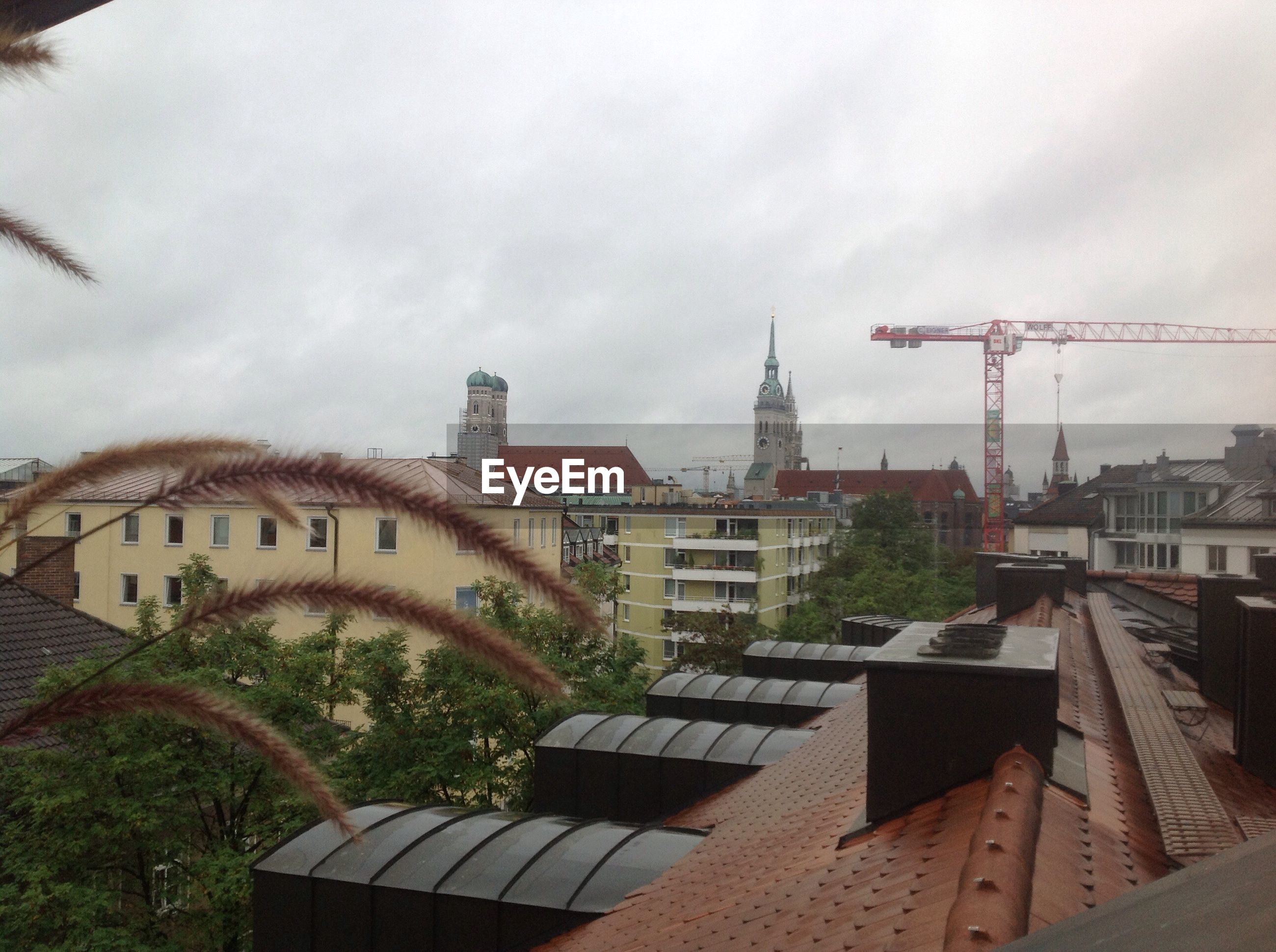 VIEW OF BUILDINGS AGAINST CLOUDY SKY
