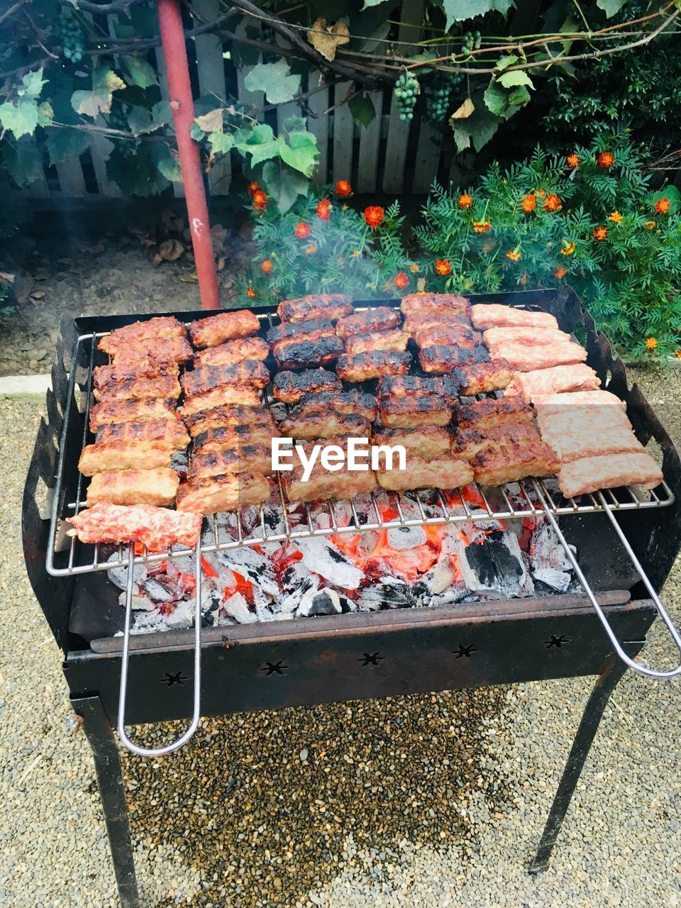 food, food and drink, meat, barbecue, freshness, grilled, preparation, barbecue grill, heat - temperature, day, preparing food, no people, front or back yard, wellbeing, high angle view, healthy eating, nature, outdoors, skewer, metal, temptation, lamb - meat