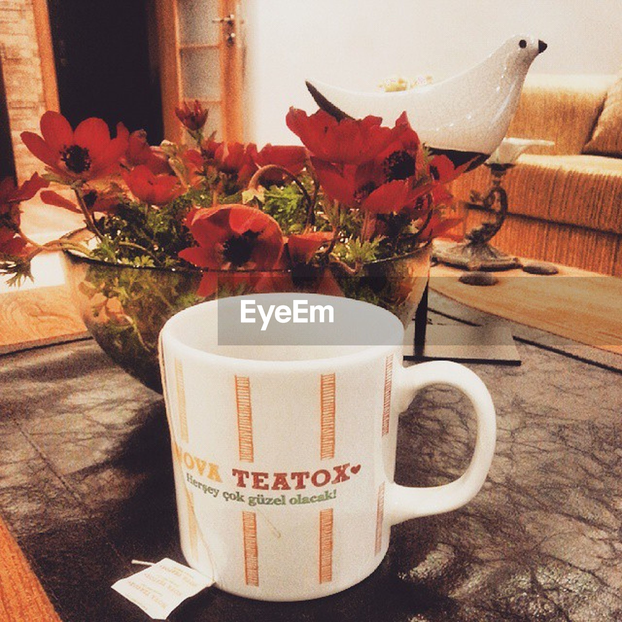 table, drink, coffee cup, indoors, food and drink, freshness, refreshment, coffee - drink, saucer, coffee, still life, flower, cup, text, close-up, wood - material, high angle view, red, spoon, vase