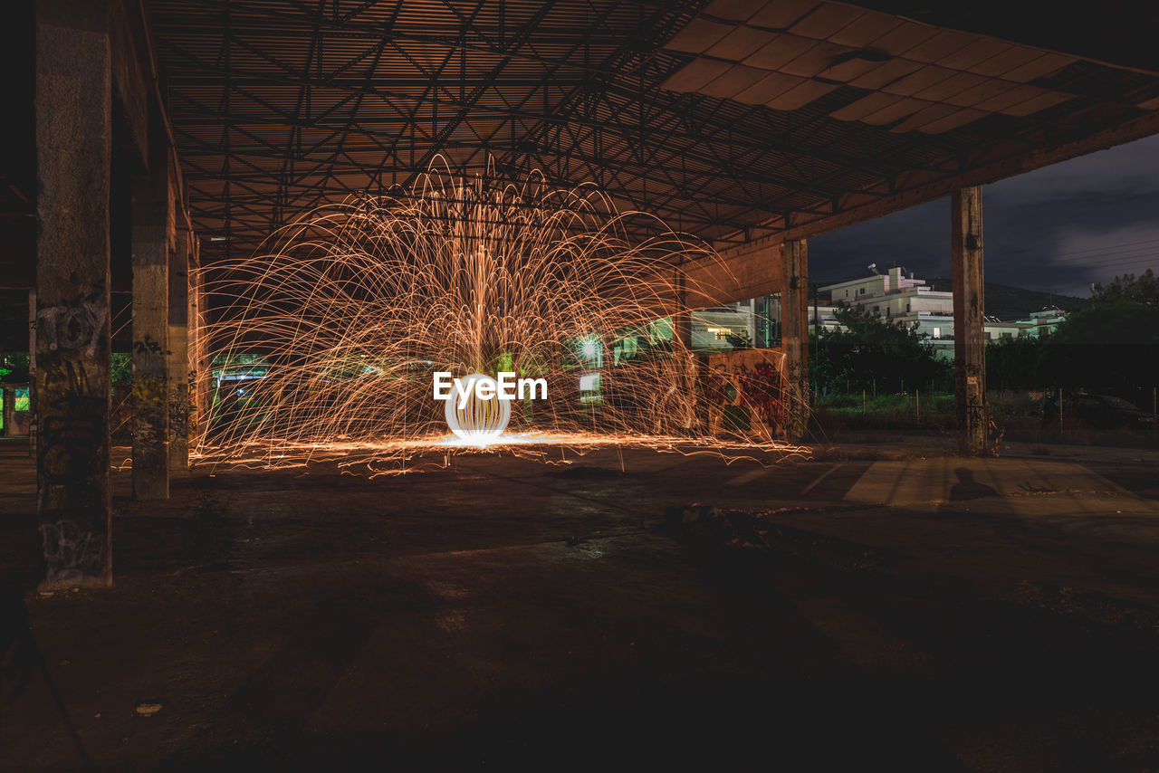 night, motion, illuminated, long exposure, blurred motion, architecture, glowing, wire wool, spinning, built structure, nature, light painting, outdoors, no people, speed, city, light trail, sky, sparks, the way forward