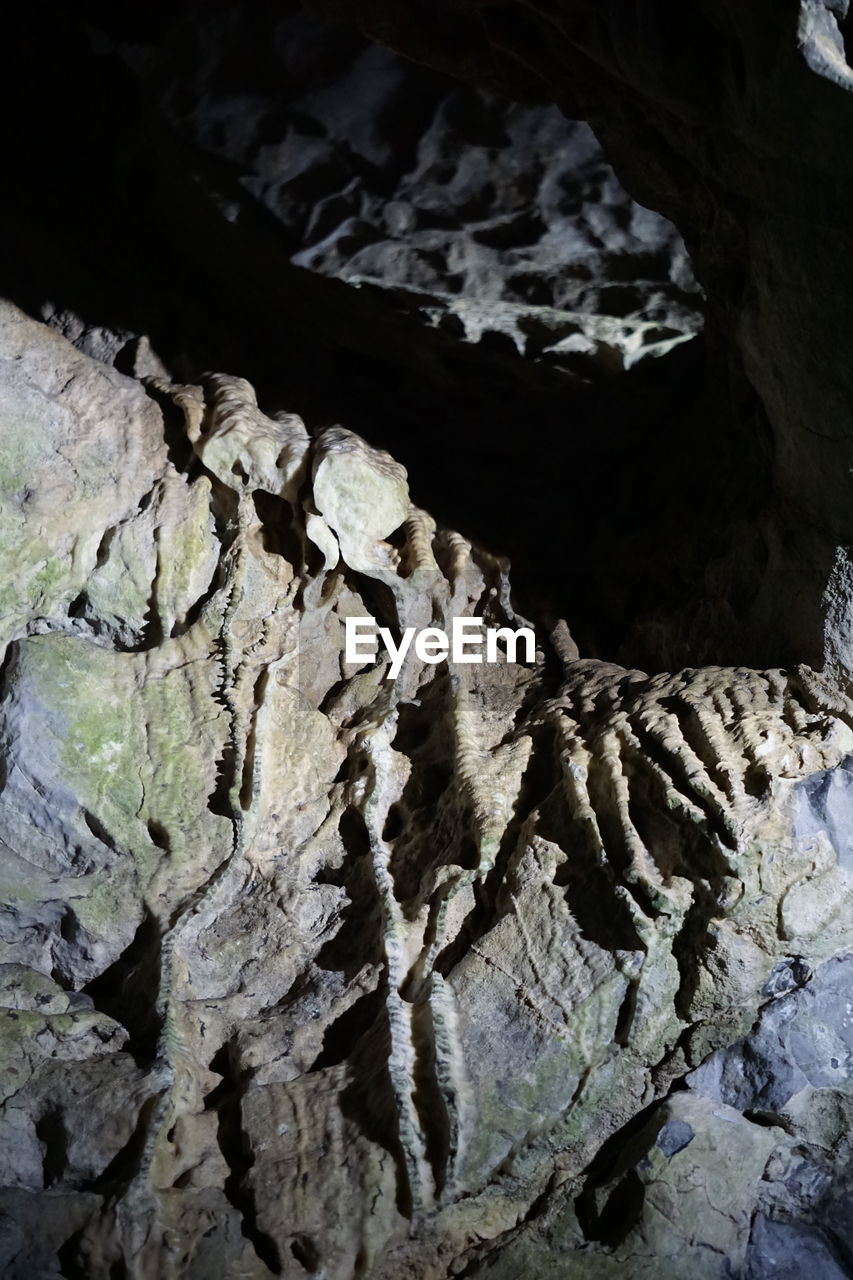rock - object, geology, cave, textured, no people, nature, physical geography, indoors, day, beauty in nature, close-up