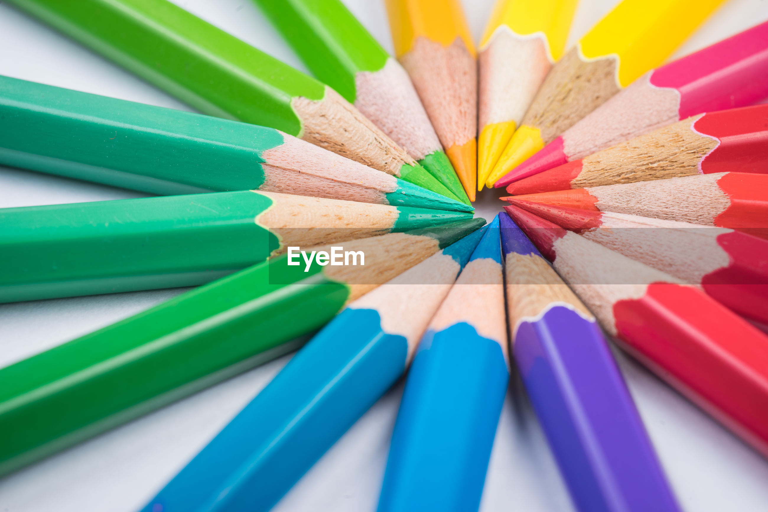 Close-up of multi colored pencils on white background