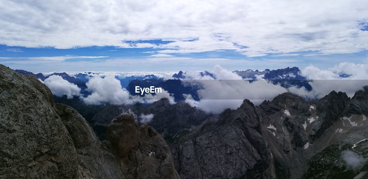 cloud - sky, sky, beauty in nature, scenics - nature, tranquil scene, tranquility, mountain, non-urban scene, rock, nature, mountain range, no people, rock - object, environment, solid, day, rock formation, idyllic, landscape, geology, outdoors, formation, mountain peak, eroded