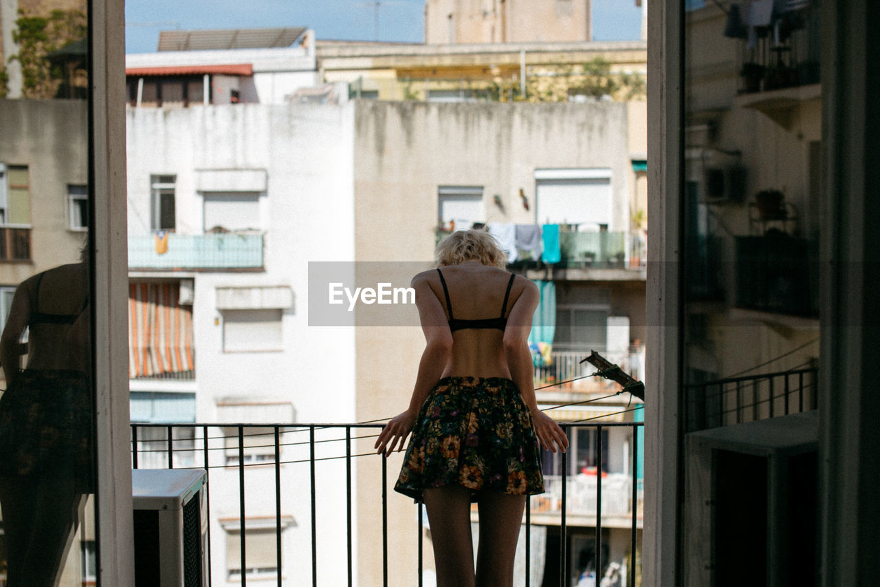 Rear View Of Woman With Window