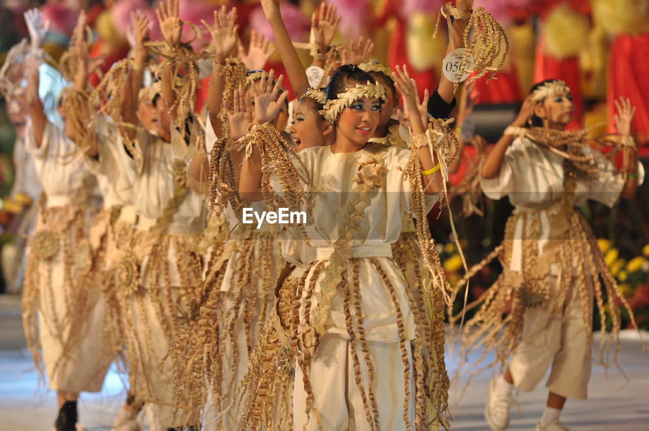 Smiling Artists Performing Traditional Dance During Carnival