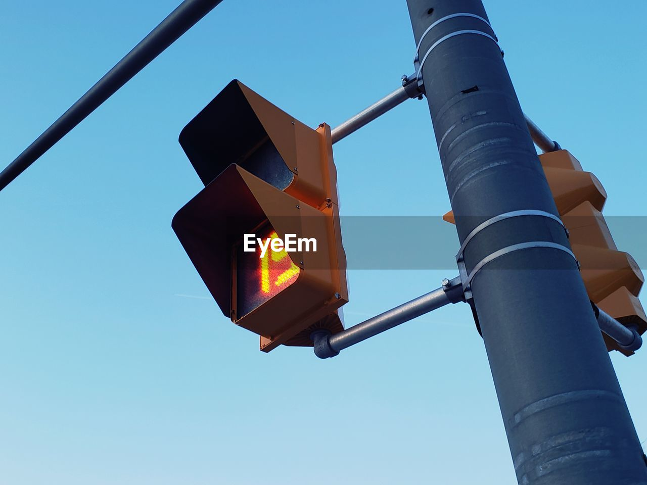 low angle view, sky, road signal, nature, blue, day, clear sky, no people, outdoors, stoplight, lighting equipment, metal, guidance, sign, pole, light, safety, communication, illuminated, technology