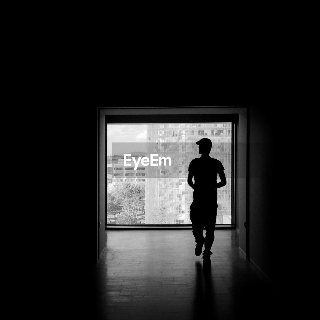 Full Length Of Silhouette Man Standing In Empty Room