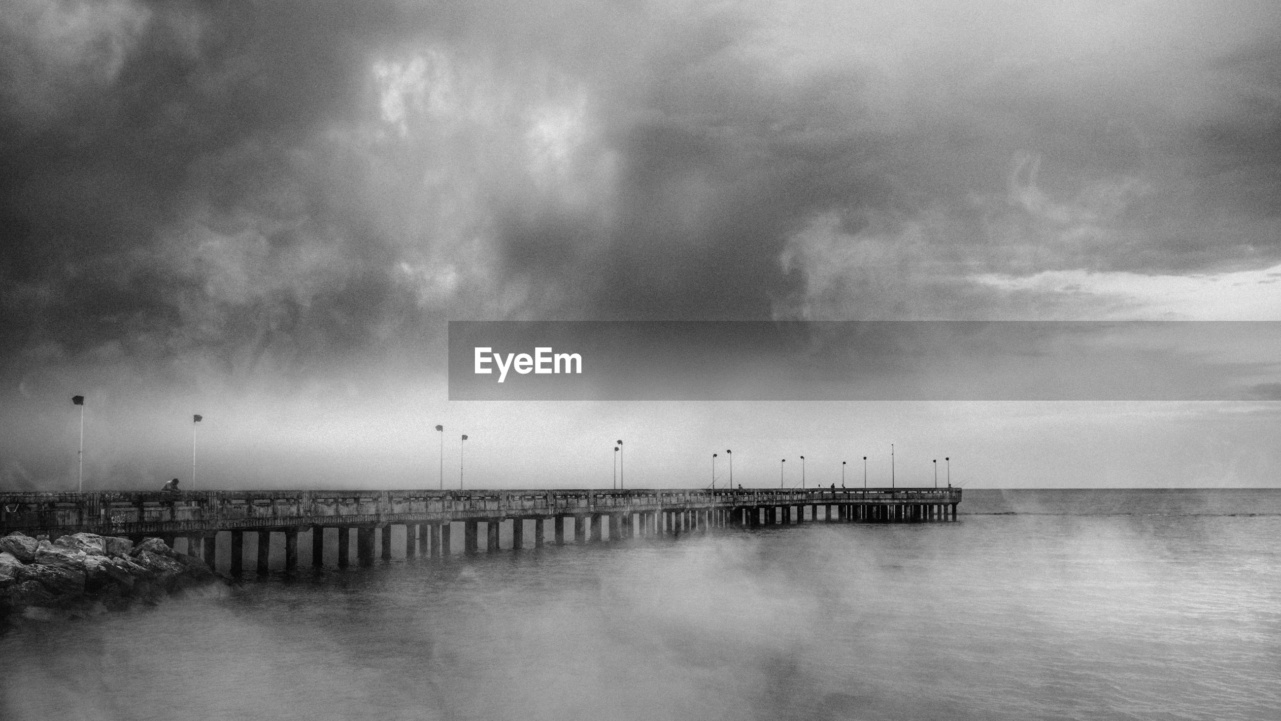 SCENIC VIEW OF PIER OVER SEA AGAINST SKY