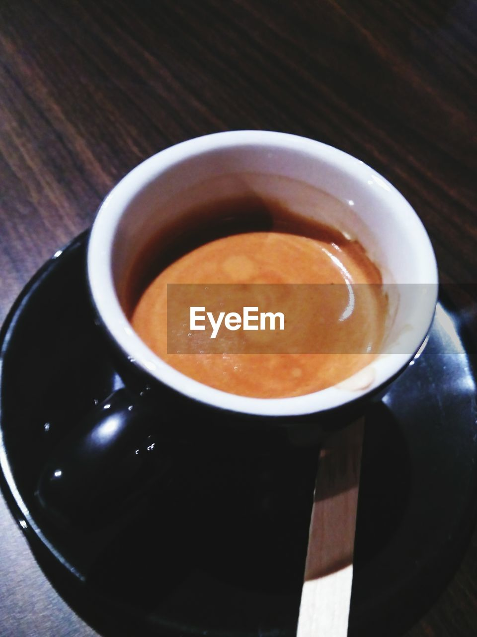 drink, food and drink, coffee cup, coffee - drink, refreshment, table, cup, freshness, indoors, high angle view, no people, frothy drink, close-up, saucer, healthy eating, cappuccino, food, froth art, day