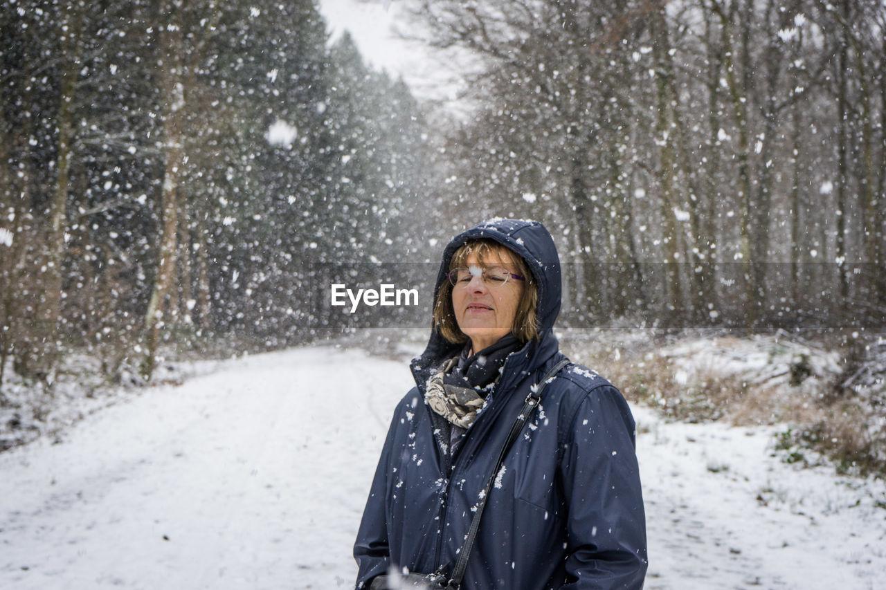 Portrait Of Woman In Forest In Winter