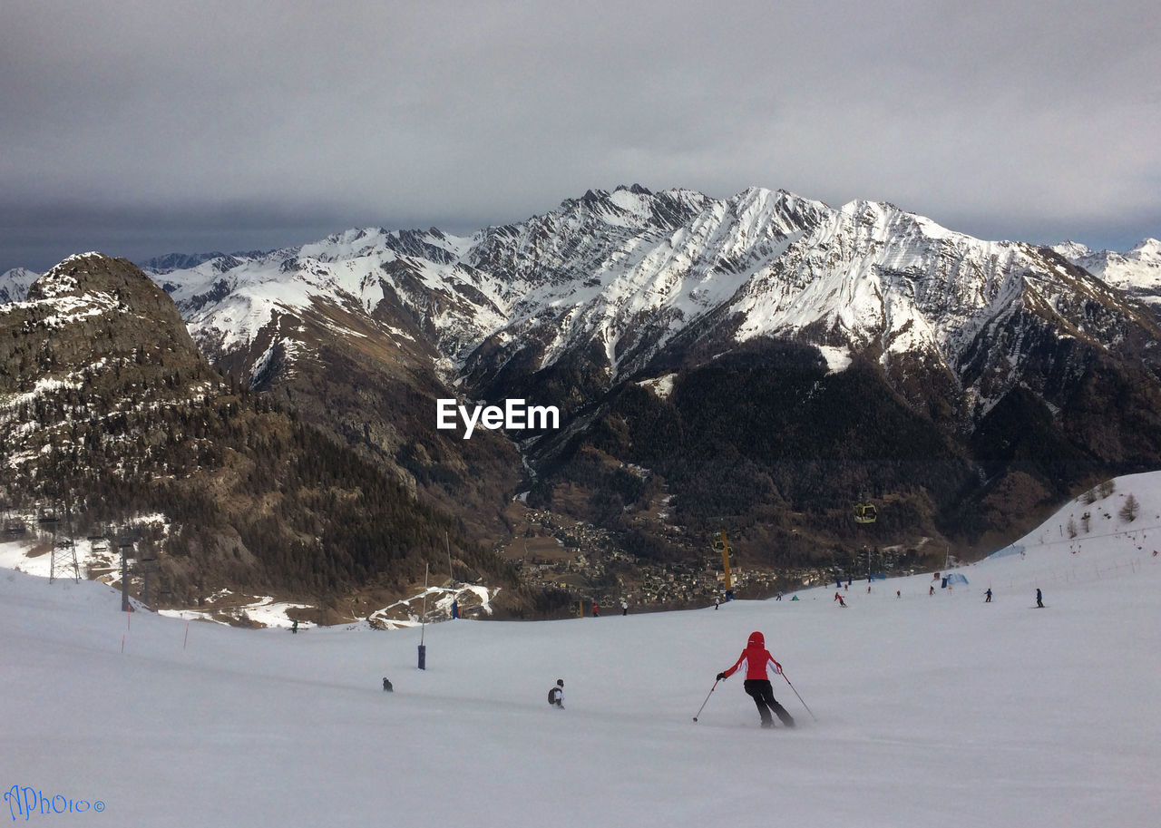 People Skiing Against Snowcapped Mountainn Against Sky