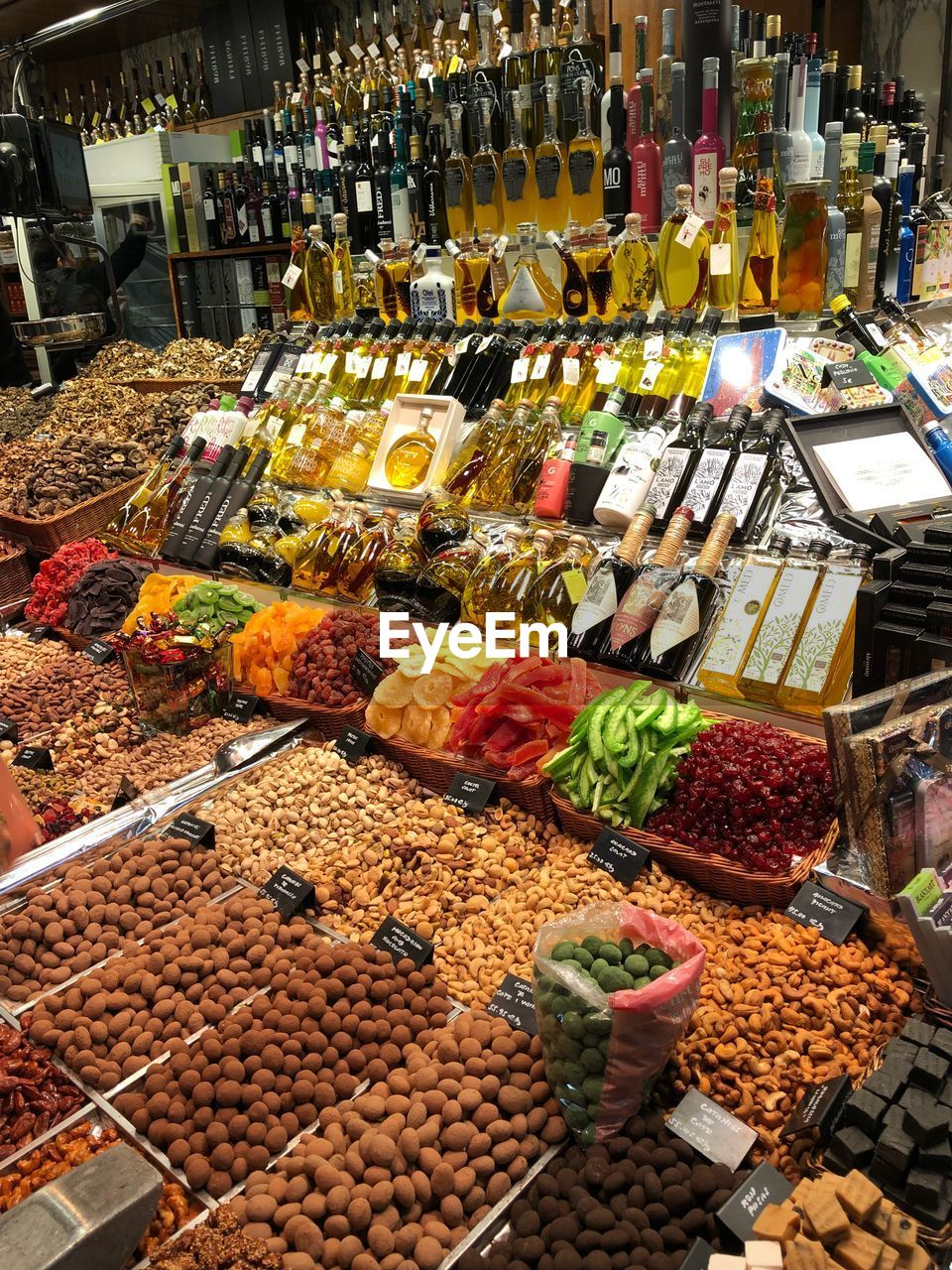 variation, food and drink, food, retail, abundance, choice, healthy eating, large group of objects, market, market stall, freshness, for sale, price tag, vegetable, fruit, arrangement, indoors, nut - food, no people, dried fruit, day, multi colored, supermarket