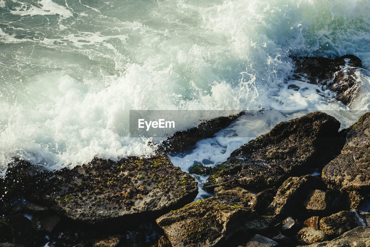 water, rock, sea, motion, solid, rock - object, beauty in nature, wave, nature, beach, day, land, sport, no people, aquatic sport, power in nature, power, scenics - nature, outdoors, breaking, hitting, flowing water, rocky coastline