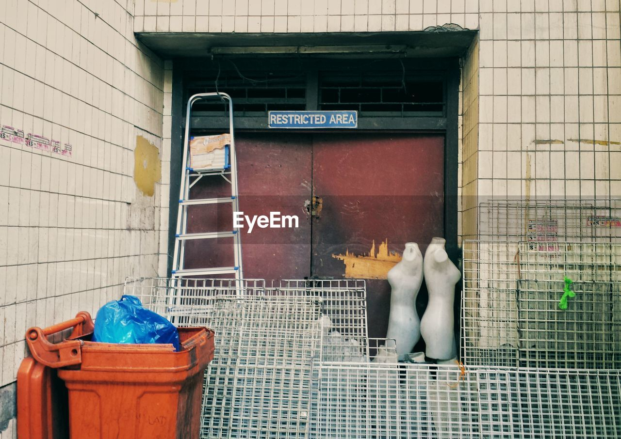 Metal Grates And Garbage Bin Against Building