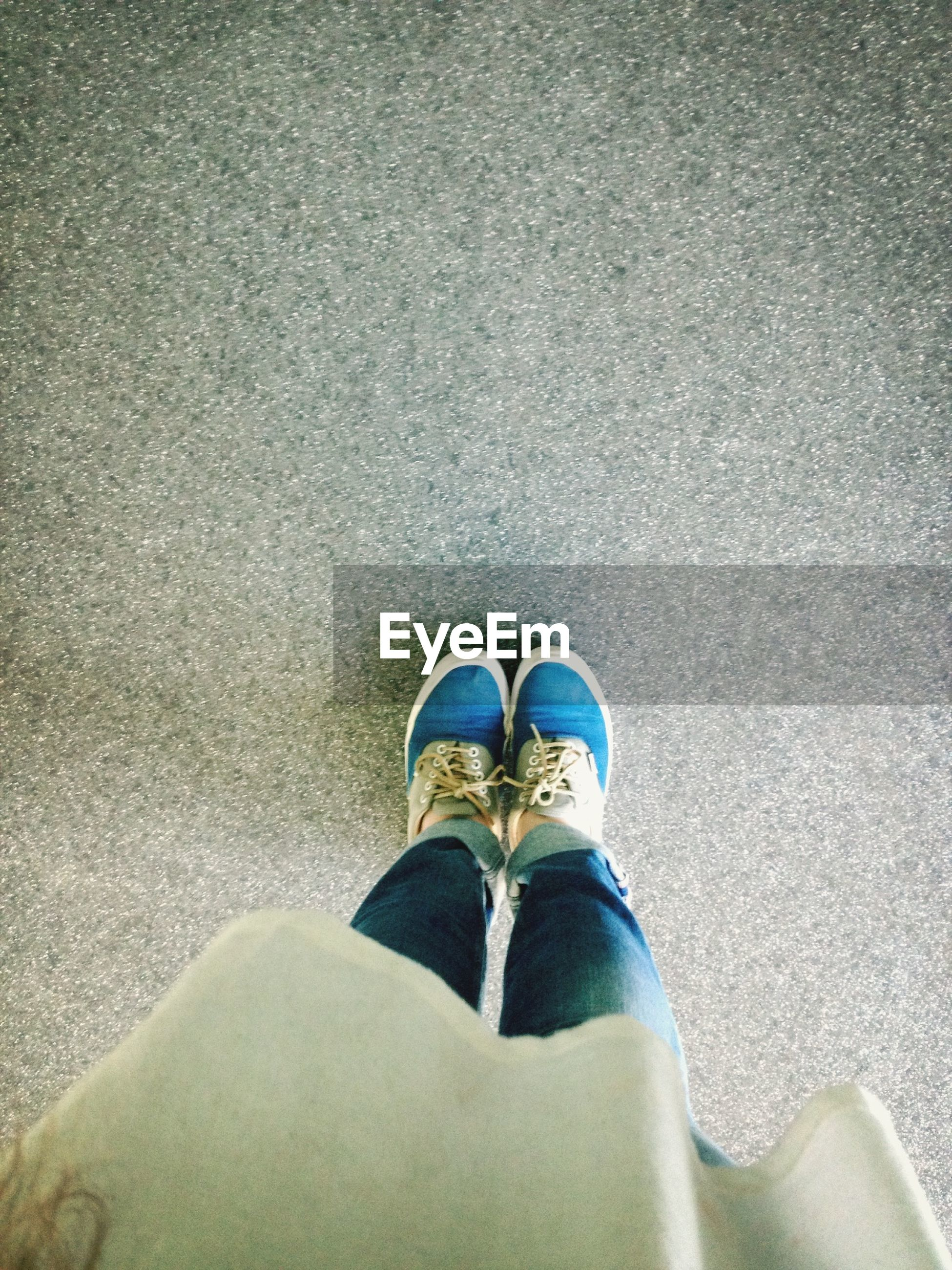 low section, person, shoe, personal perspective, standing, human foot, footwear, lifestyles, high angle view, leisure activity, jeans, street, men, directly above, unrecognizable person, day