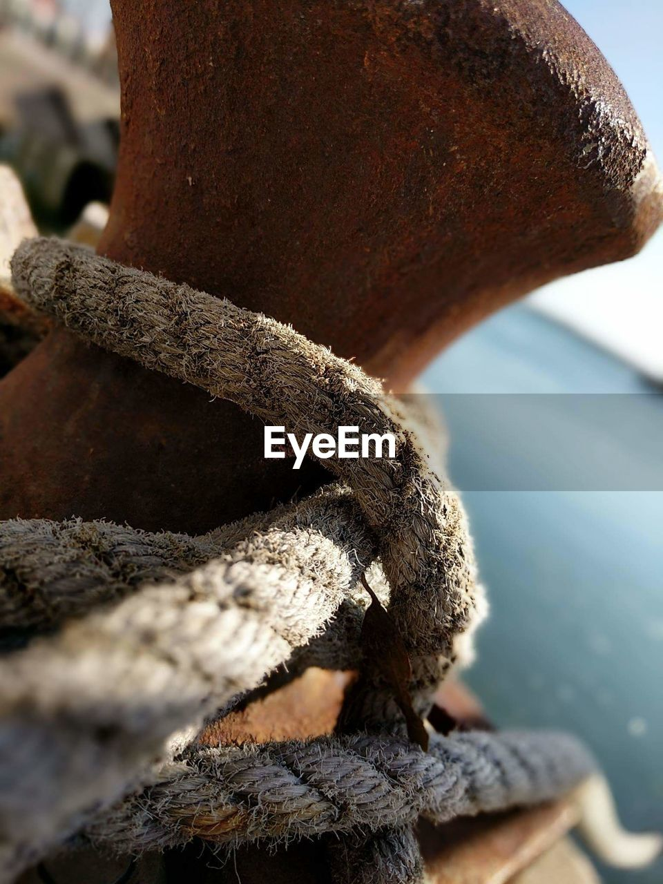 close-up, rope, no people, focus on foreground, day, strength, textured, detail, nature, outdoors, tied up, connection, selective focus, brown, metal, pattern, rough, mode of transportation, rusty, twisted