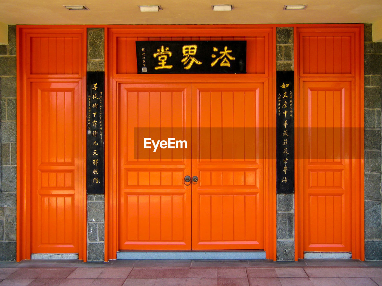 entrance, door, architecture, built structure, closed, orange color, building exterior, wood - material, no people, building, day, security, safety, red, text, protection, outdoors, house, front door, repetition, garage