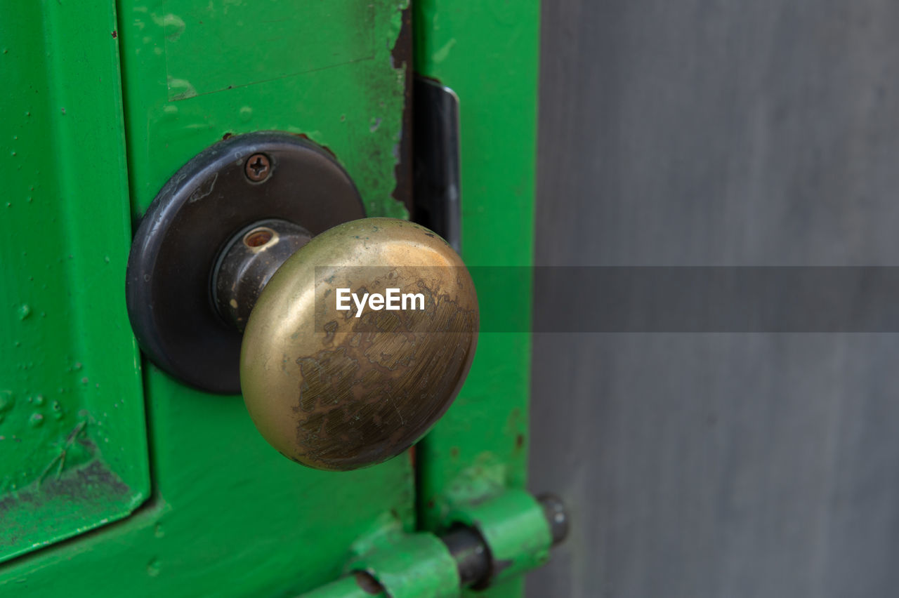 metal, door, close-up, entrance, green color, doorknob, knob, protection, lock, no people, security, safety, day, old, handle, outdoors, selective focus, focus on foreground, closed, keyhole, latch