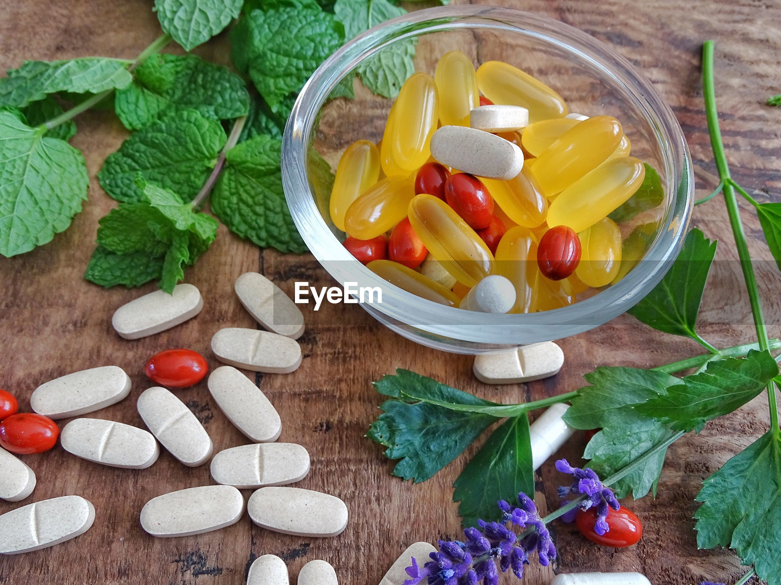 High angle view of  bowl with fish oil pills