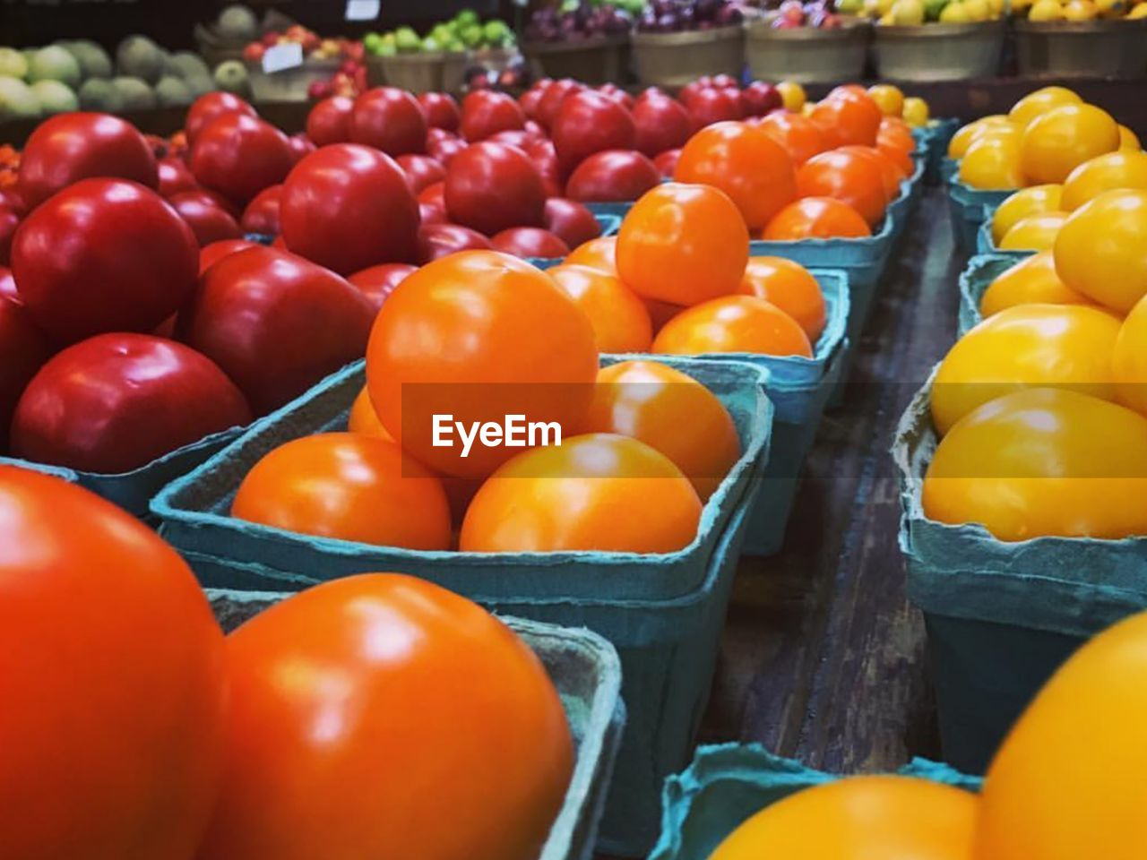 TOMATOES FOR SALE IN MARKET STALL